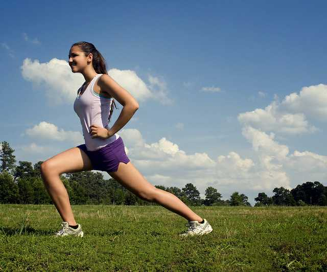 15250-a-young-woman-stretching-outdoors-before-exercising-pv.jpg