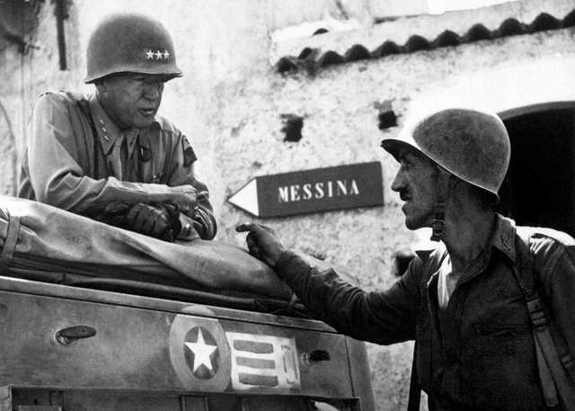 Patton_speaking_with_Lt._Col._Lyle_Bernard,_at_Brolo,_circa_1943.jpg