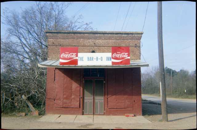 William-Christenberry,-Bar-B-Q-Inn,-Greensboro,-Alabama,-1971,-Dye-transfer,-printed-1990,-APIV,-8-x-10-inches,-The-Estate-of-William-Christenberry,-Courtesy-of-Hemphill-Fine-Arts.jpg