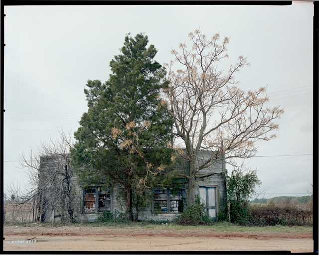 William-Christenberry,-Palmist-Building,-Winter-View,-Havana-Junction,-AL,-Dye-transfer-print,-1981,-20-x-24-inches,-Ogden-Museum-of-Southern-Art,-Gift-of-the-Roger-H.-Ogden-Collection.jpg