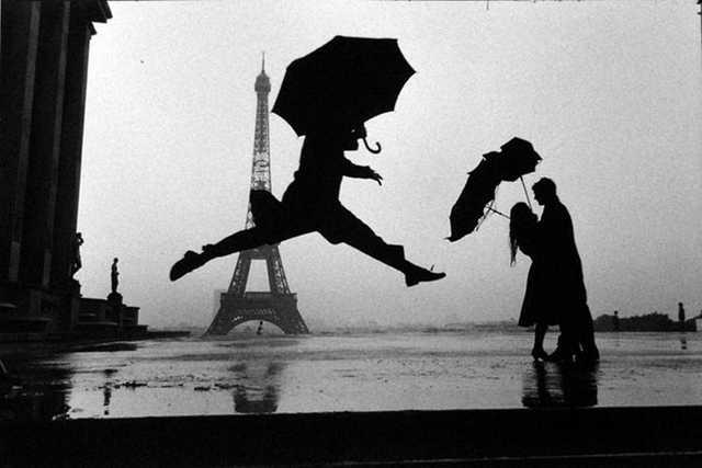 Elliott Erwitt Paris, France (Man Jumping with Umbrella)