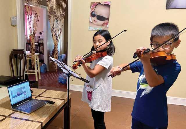 2020.05.22---Peleh-and-Nelah-PhaLe---WHAM---Violin---Practicing-at-Home.jpg