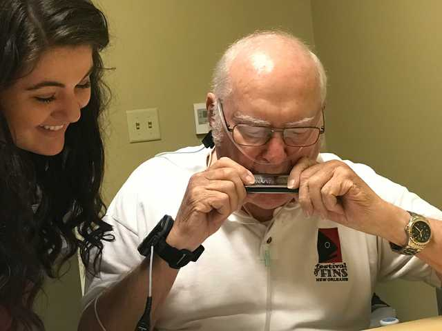 Pulmonary-rehabilitation-patient-playing-the-harmonica-as-part-of-Baton-Rouge-General-Hospital_s-Art-in-Medicine-program.-Playing-the-harmonica-helps-to-improve-lung-function.jpg