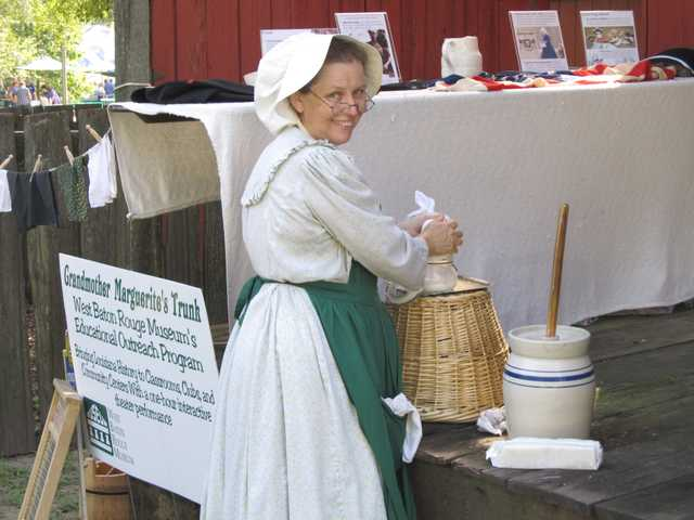 Grandmother Marguerites Trunk - photo - farm woman with churn.jpg